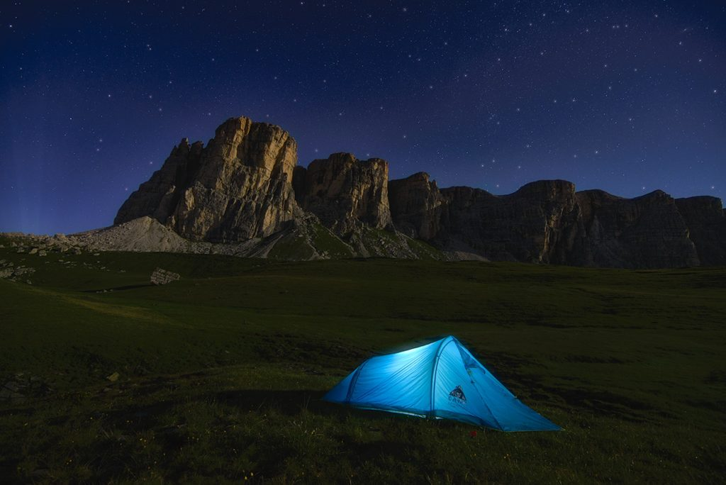 Night landscape with tent in foreground