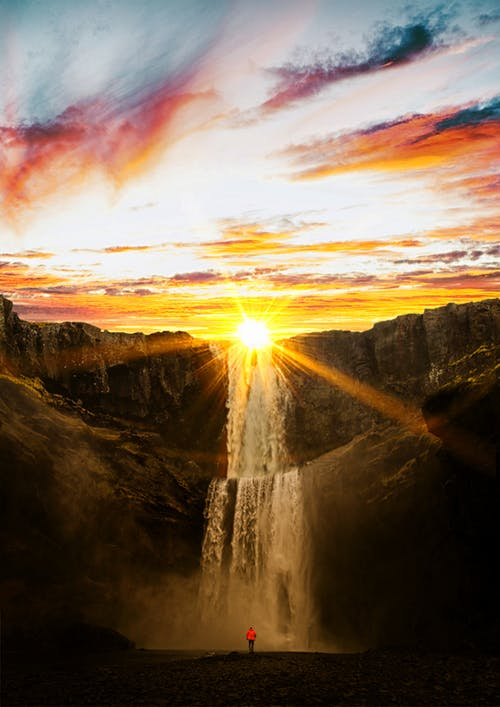 waterfall with sunburst