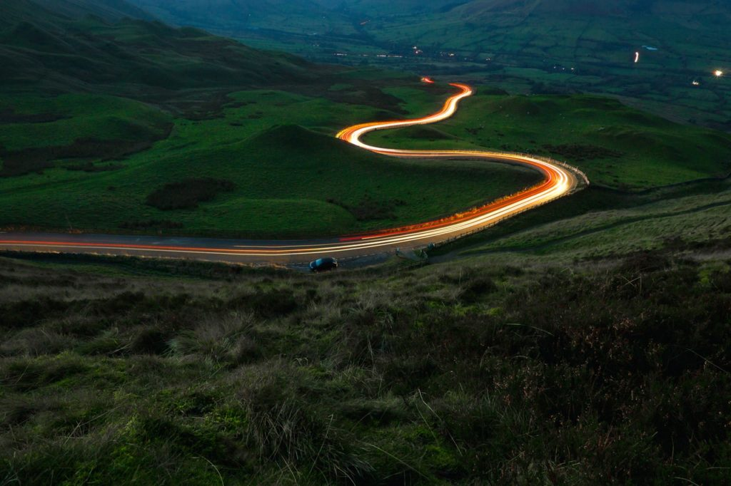Light trails from traffic snaking along a rural road
